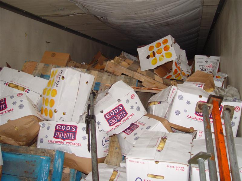 broken cartons and bottles in container